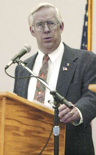Libertarian U.S. Senate candidate Stan Jones, speaks Sept. 23, 2002, during a debate at the Great Falls Civic Center in Great Falls, Mont. Jones has a distinct blue-gray skin color, the result of taking too much of an anti-bacterial form of pure silver. Jones said he started taking colloidal silver in 1999 in preparation for what he feared might be Y2K disruptions that could lead to a shortage of antibiotics. (AP Photo/The Tribune, John W. Liston)